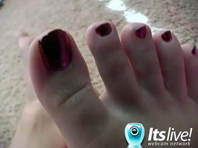 Camgirl with small tits shows her toes